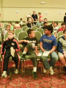 Drew Justice (far left) awaits the awards ceremony, giving him 15th place in the K-3 Championship section.