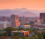 Sunset adds a warm glow to the mountains surrounding Asheville, North Carolina